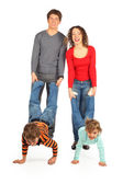 Parents hold children for legs — Foto Stock