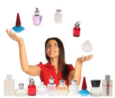 Woman looking up and juggling perfumes collage — Stock Photo