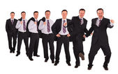 Bussinessmen striking different poses collage — Stock Photo