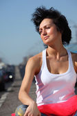 Portrait of girl in pink skirt on highway — Stock Photo