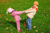 Brother and sister playing in the park — Stock Photo