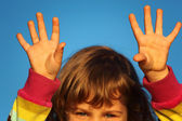 Little girl with lifted hands closeup — Stock Photo