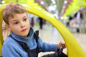 Boy in store — Stock Photo