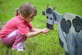 The girl and the boy feed a wooden animals — Stock Photo