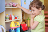 Young girl thinking on kitchen — Stock Photo
