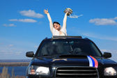 Bride is glad standing in car — Stock Photo