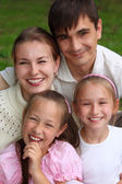 Family of four outdoor in summer — Stock Photo