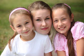 Mother with daughters outdoor in summer — Stock Photo