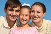 Portrait of parents and daughter against sky — Stock Photo