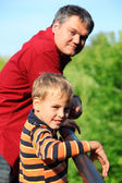 Man and boy outdoor in summer — Stock Photo