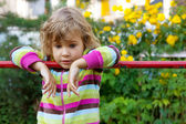 Young girl has a rest in backyard — Stock Photo