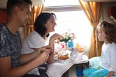 Family eats in train — Stock Photo