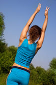 Woman back during fitness in the country — Stock Photo