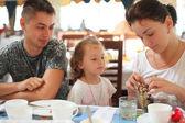 Family in cafe — Stock Photo