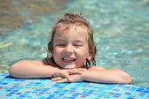 Pretty little girl bathe in pool, closed eyes — Stock Photo