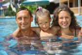 Family in pool — Stock Photo
