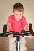 Boy on training apparatus — Stock Photo
