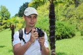 Photographer in sochi arboretum — Stock Photo