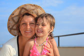 Mature woman with little girl on veranda — Stock Photo