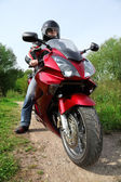 Motorcyclist standing on country road, closeup — Stock Photo