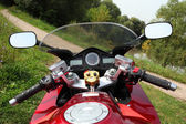 Motorcycle on country road — Stock Photo