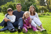 Happy family of four persons outdoors — Stock Photo