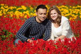 Man and woman in braces in flowering park — Stock Photo