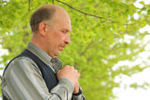 Portrait of middle-aged praying man outdoor — Stock Photo