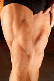 Closeup photo of bodybuilder legs — Stock Photo