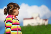 Girl looking at the home — Stock Photo
