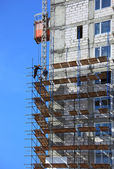 Building in scaffolds — Stock Photo