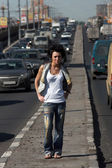 Girl on highway middle in city — Stock Photo