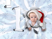 Christmas baby from ragged wall — Stock Photo