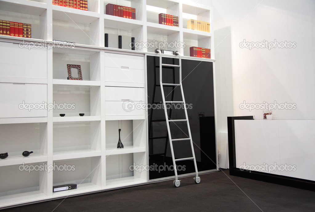 White room with book cabinet — Stock Photo #7424469