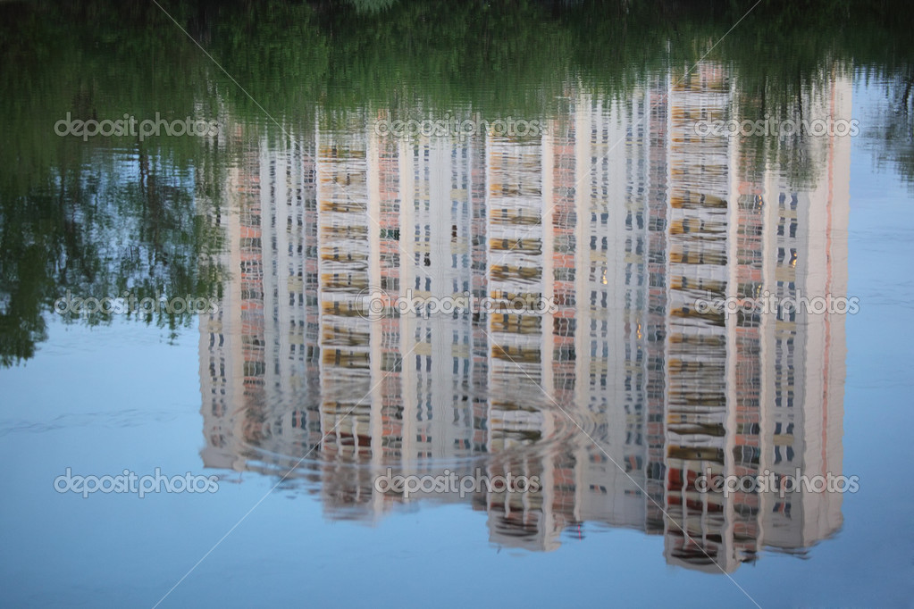 Skyscraper reflexion in water  Stock Photo #7425645