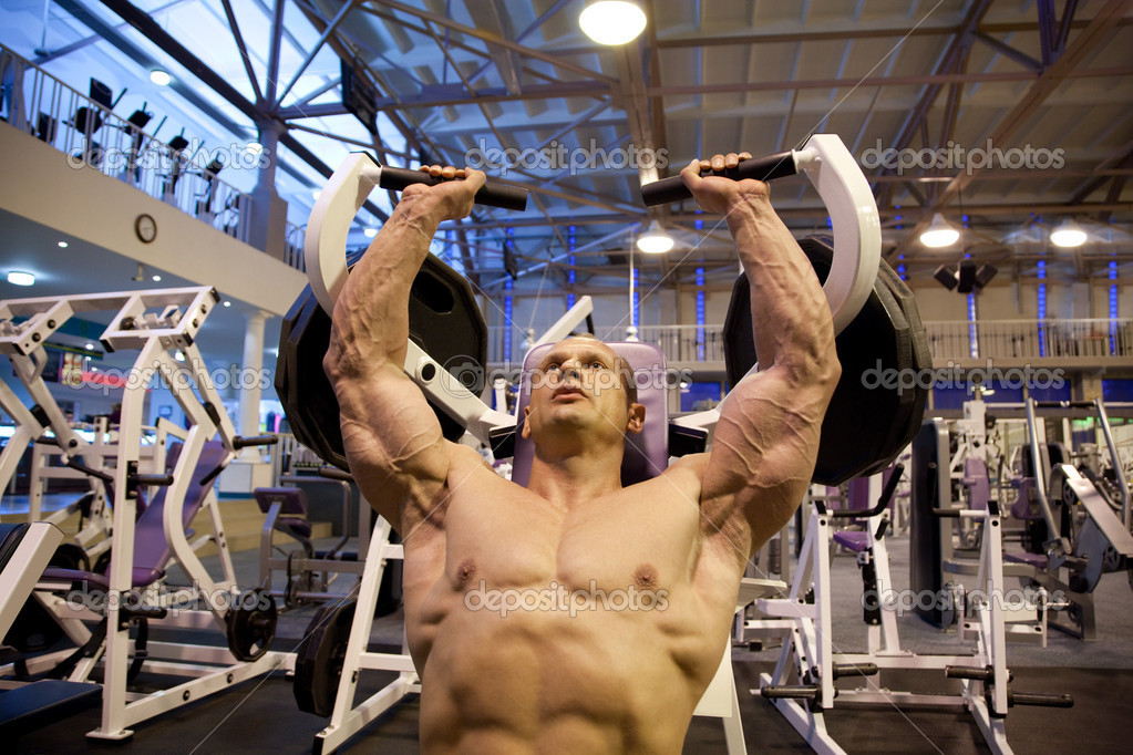 Bodybuilder doing weightlifting in gym  Stock Photo #7429686