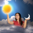 Woman in sky with clouds holds moon and sun in hands, collage — Stock Photo #7430043