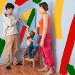 Children help parents to do repair room, collage - Photo