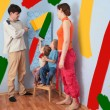 Children help parents to do repair room, collage - Stock Photo