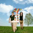 Father, mother and child on grass with kite, collage — Stock Photo