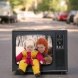 Mother and baby are in the old television set collage — Stock Photo