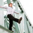 Man on the bridge - Stock Photo