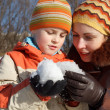 Mum with the son play with snow outdoor — Stock Photo