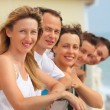 Five smiling friends on balcony — Stock Photo