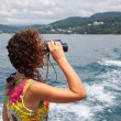 Observing in binocular sea coast — Stock Photo