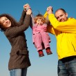 Little girl with mum and daddy - Stock Photo