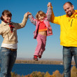 Family of four sunny autumn day — Stock Photo