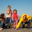 Family of four sunny autumn day — Stockfoto