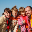 Family of four sunny autumn day - Stock Photo