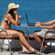 Family resting on sea with laptop — Stock Photo